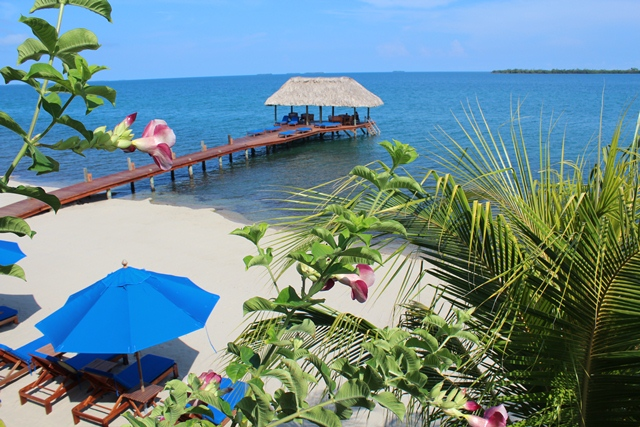650 Pier with Flowers in Foreground - Chabil Mar Belize Resort