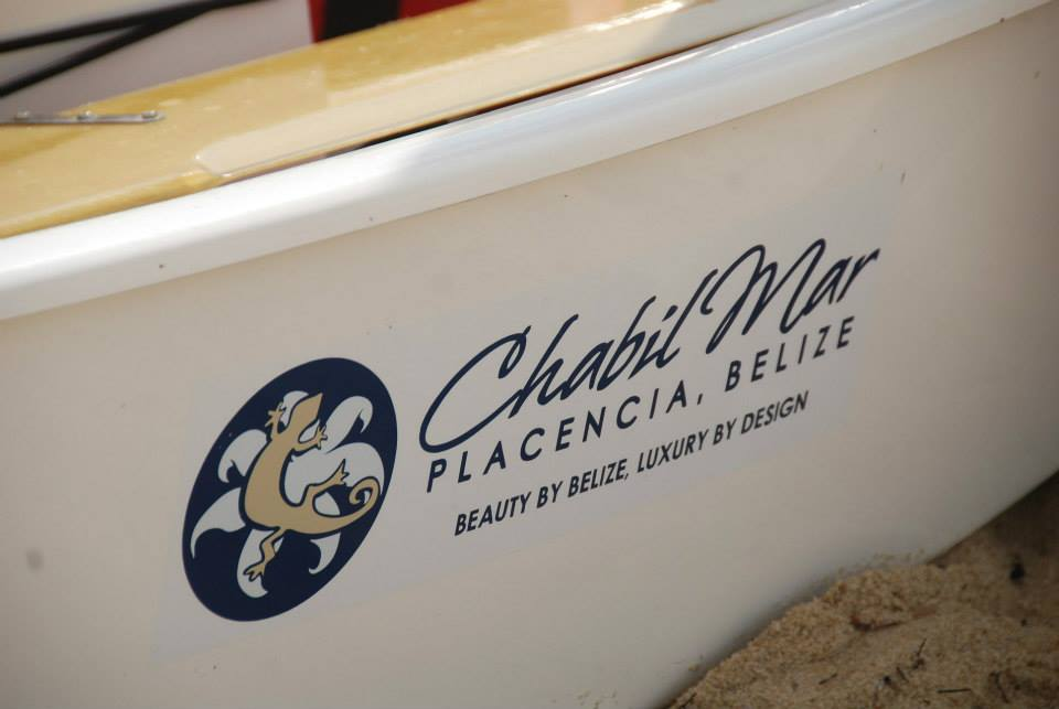 Logo closeup on boat Chabil Mar Belize Resort
