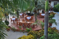 Even Dining is among the flora and beach at Al Fresco at Chabil Mar's Cafe Mar by the Sea