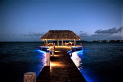 Evening Dinners by Reservation on our Underlit Pier over the Caribbean